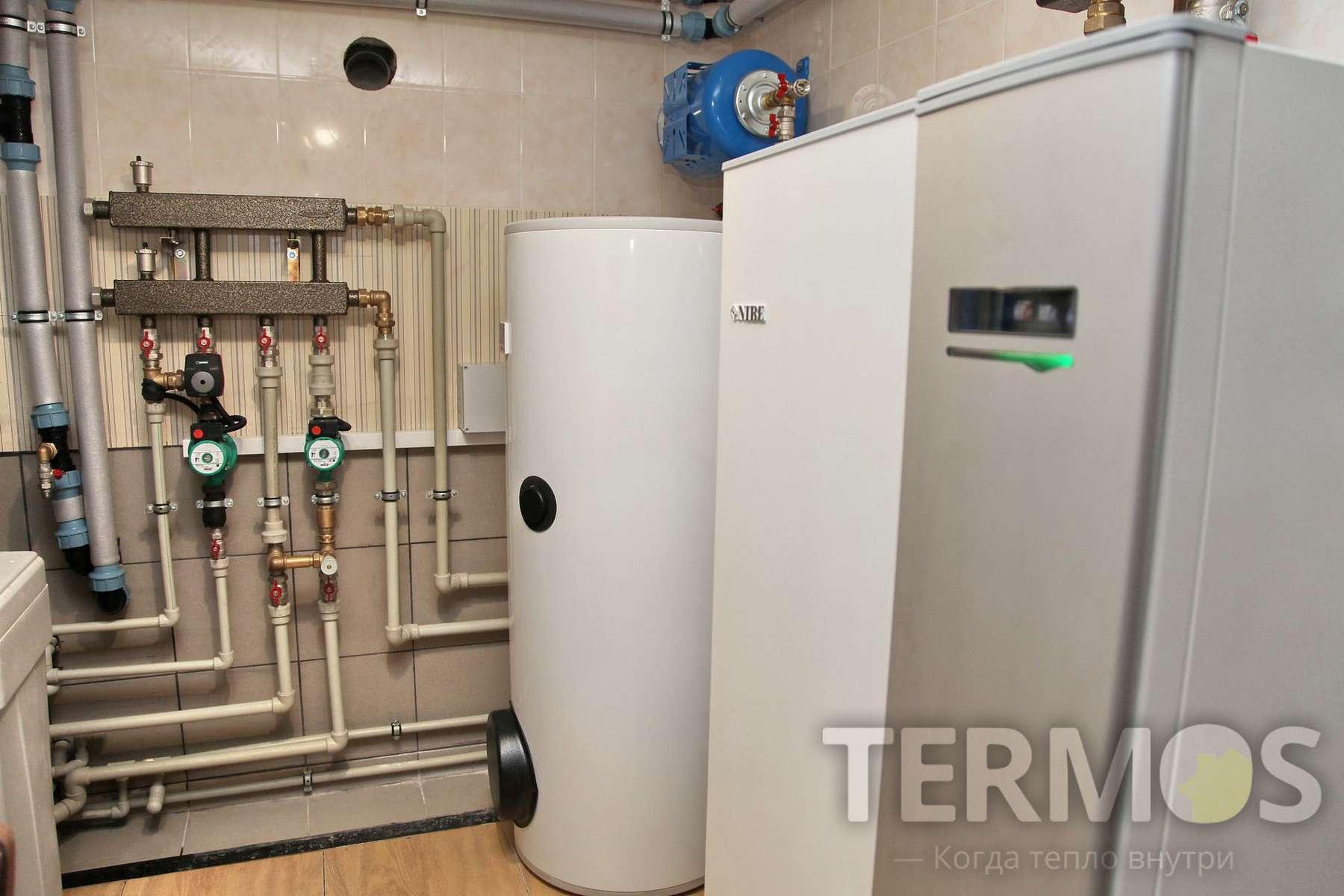 Киев. Дом 250 кв м. NIBE (Швеция) 12 кВт, четыре геотермальные скважины по 60 м. Экономичная система отопления на геотермальном тепловом насосе  NIBE (Швеция) 12 кВт c 4 геотермальные скважинами по 60 м