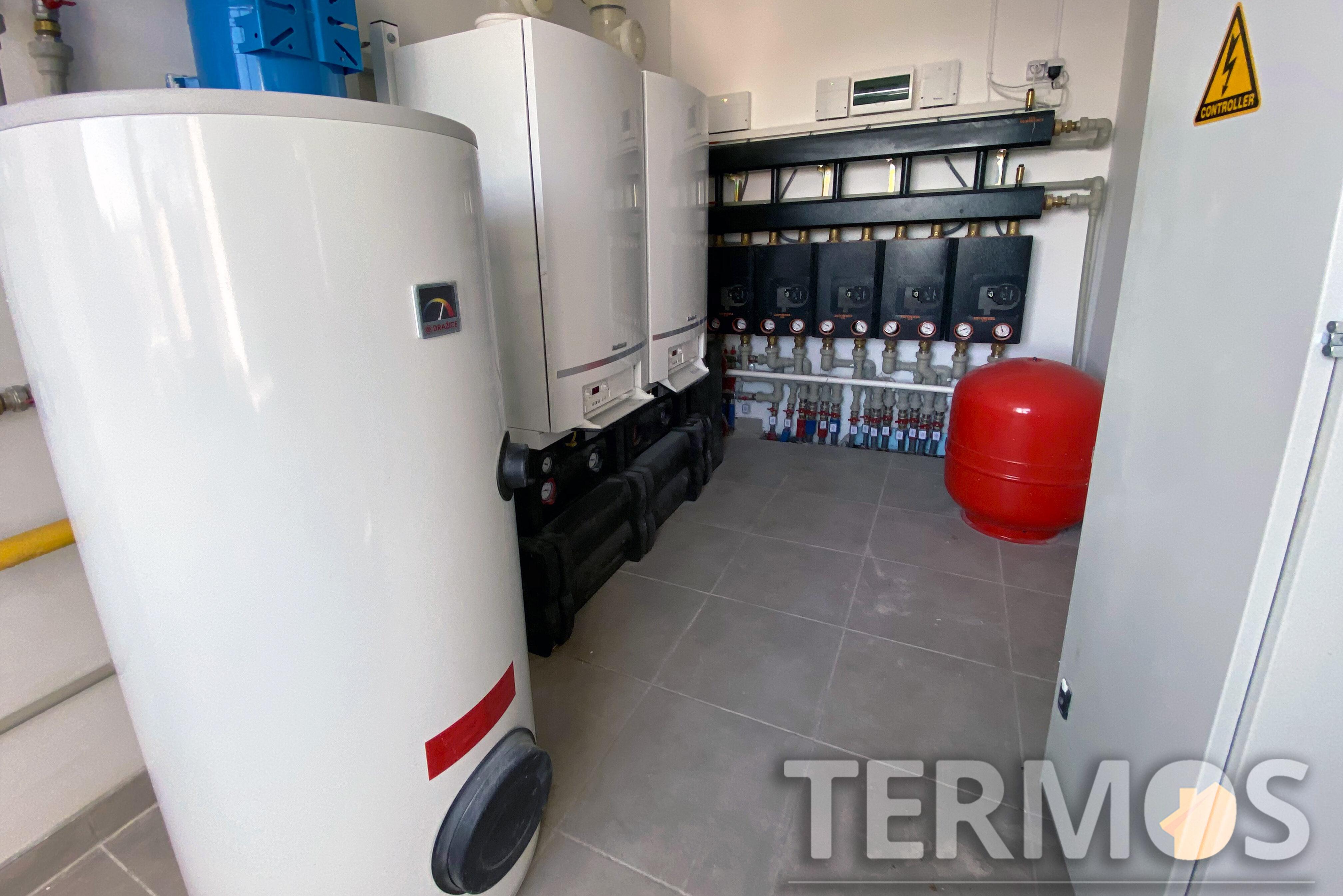 Офисный центр. Система отопления на каскаде из двух конденсационных газовых котлов Vaillant (Германия) по 96 кВт с бойлером косвенного нагрева 400 л