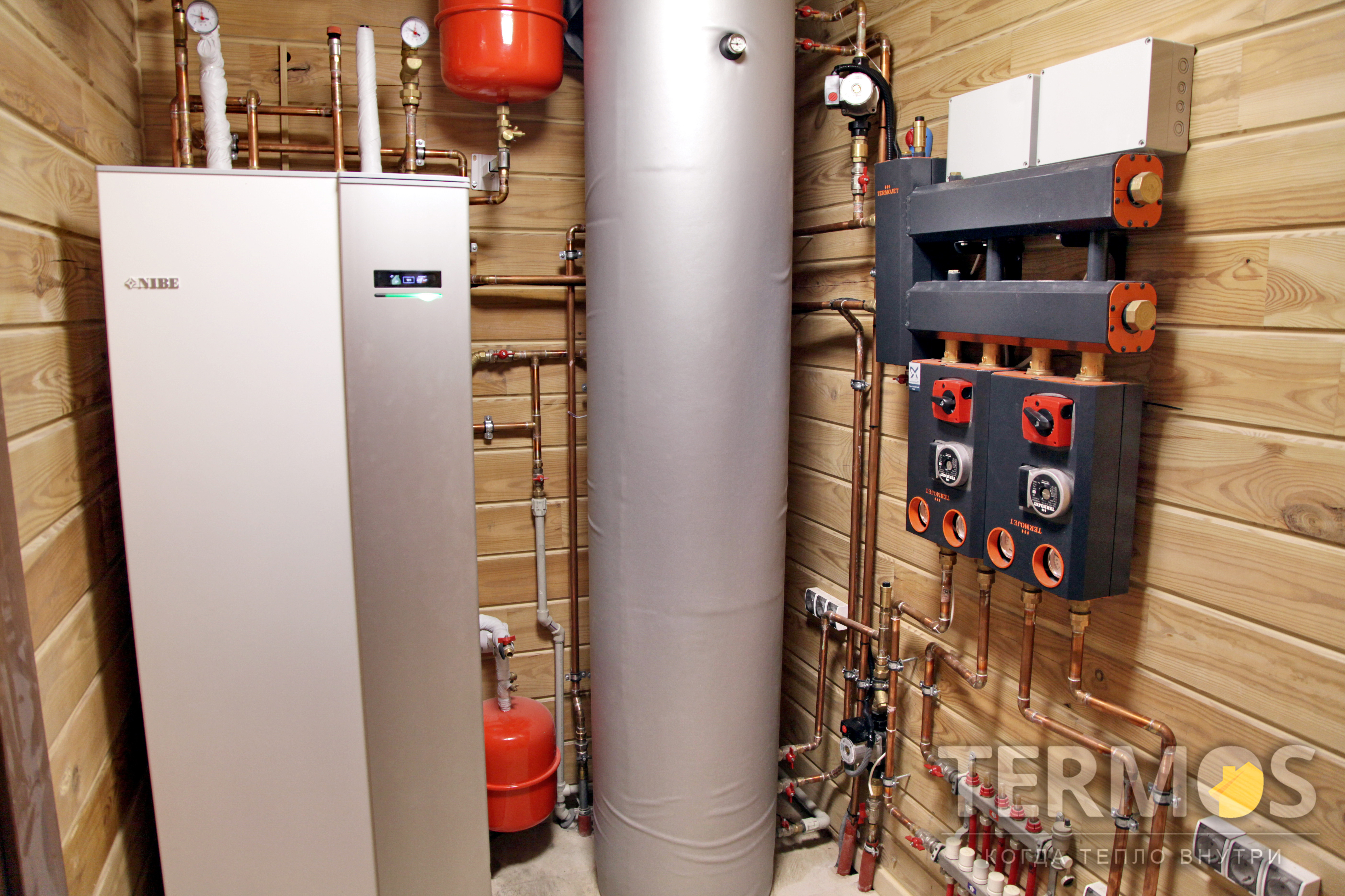 Дом из бруса 150 кв м. Тепловой насос NIBE F1245 10 кВт, с встроенным бойлером 180 л. 3 Геотермальные скважины по 90 м
