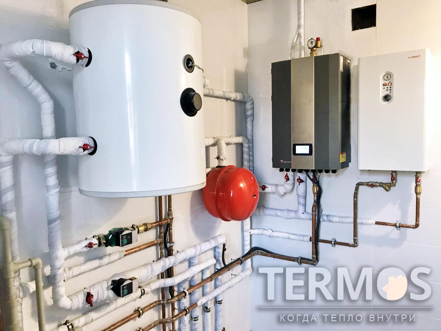 Козин. Коттедж 200 кв.м. Внутренний блок воздушного теплового насоса Mycond. В качестве дополнительного нагрева используется электрический котёл Protherm 18 кВт